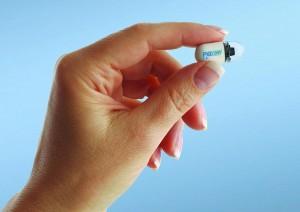 Hand holding PillCam SB 2